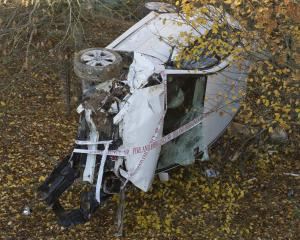 A vehicle wound up in a paddock 10m below SH87 at Lee Stream after striking black ice this...