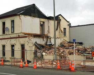 Demolition work started and then stopped at the former Scribes bookshop in North Dunedin. PHOTO:...