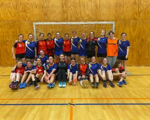The Otago and Canterbury women's handball teams pose after competing in the South Island Shield...