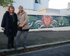 Dunedin Night Shelter Trust chairwoman Clare Curran stands with artist Jacqui Tangney, who...