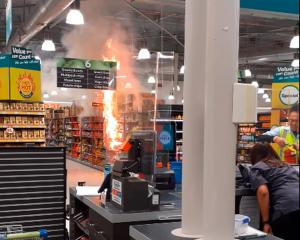 The fire at the Countdown Henderson, inside WestCity mall, last night. Photo: Hayley Rayner