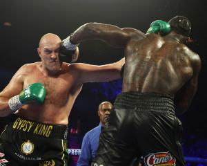Tyson Fury (left) and Deontay Wilder during their second fight. Photo: Getty Images