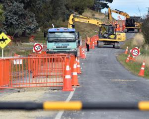 Construction crews work on the installation of a new water pipeline in Waikouaiti. PHOTO: PETER...