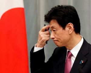 Economy Minister Yasutoshi Nishimura. Photo: Reuters