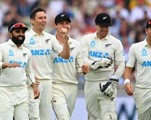New Zealand paceman Trent Boult (second left) celebrates with team-mates (from left) Ajaz Patel,...