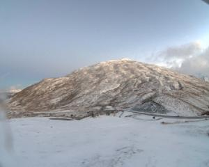 Snow on the Crown Range Road this morning. Photo: MetService webcam