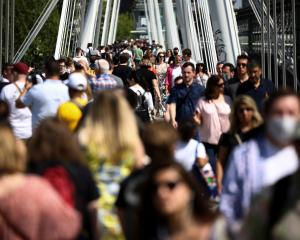 People out and about in central London. The government has stressed any easing of restrictions...