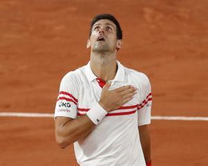 Novak Djokovic celebrates winning his semifinal match against Rafael Nadal. Photo: Reuters