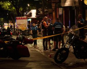 Police at the scene of the shooting in the Sixth Street entertainment district area of Austin....