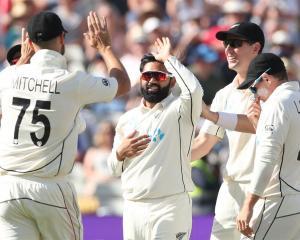 New Zealand's Ajaz Patel celebrates after taking the wicket of England's James Bracey. Photo:...