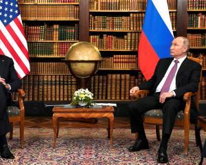 US President Joe Biden (L) and Russia's President Vladimir Putin meet for the US-Russia summit at...