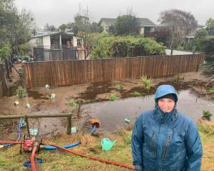 Waikuku resident Katie Gray says her garage has been flooded and it came within centimetres of...