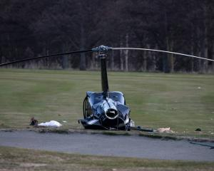 Four people, including the newlywed couple, were badly injured when the Robinson R44 II crashed...