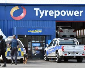 The armed offenders squad descend on a Mosgiel site after a man threatened to shoot a police...
