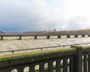 The Ashburton River has dropped a little, but is still a concern. Photo: Ashburton Courier