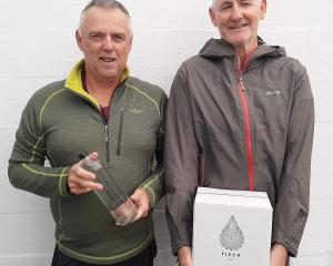 Craig Purdy (left) and Paul Robinson hold their award-winning Fleck mineral water. PHOTO: SUPPLIED