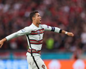 Cristiano Ronaldo celebrates a goal for Portugal during its win this morning at Euro 2020. Photo;...
