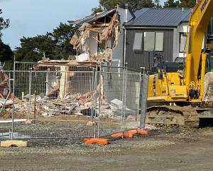 The digger and damaged home at the Flat Bush site. Photo: Supplied