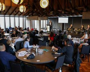 Participants at the hui yesterday listen to one of the keynote speaker, Dr Chris Wilson. Photo:...