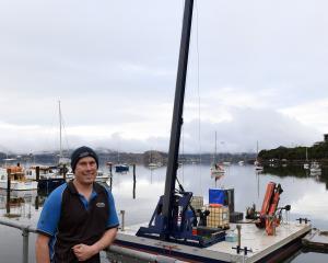 Careys Bay Marine Services owner Eldon Donaldson with his new pile-driver at Deborah Bay. PHOTO:...