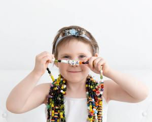 Eva Sallabanks with the beads of courage she collected during treatment the first time she was...