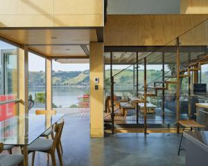 """An open-plan layout and """"see-through"""" staircase ensure that Otago harbour can be seen from almost..."""
