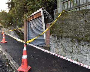 An Evans St garage has been cordoned off after it collapsed early yesterday morning. PHOTO:...