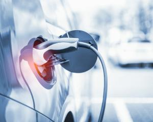 From July this year, people buying new electric vehicles (EVs) could get as much as $8625 back...