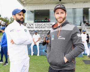 India captain Virat Kohli (L) and New Zealand captain Kane Williamson at Hagley Oval in...