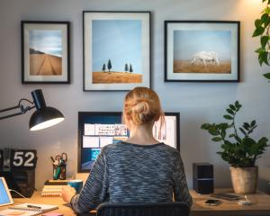 The British Government is thinking of making working from home a ''default'' option. PHOTO: GETTY...