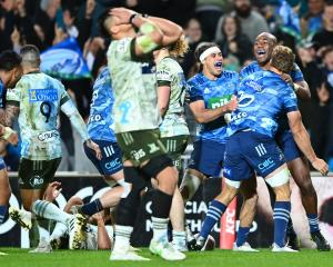 The Blues celebrate the final whistle in the Super Rugby Trans-Tasman final at Eden Park. Photo:...