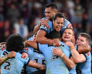 New South Wales players celebrate their victory over Queensland. Photo: Getty Images