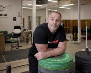 Graeme Evans back at work in the Otago Weightlifting gym after winning three medals at the World...