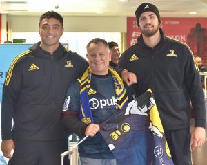 Dunedin local Phil Noye is flanked by Highlanders Teriaki Ben-Nicholas (left) and Manaaki Selby-...
