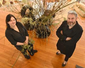 Christchurch artist Steve Carr and Estelle Flowers owner Jolene Wilkinson install In Bloom  at...