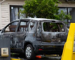 The shell of the burnt-out car at the Mt Roskill property where Tania Hadley was killed. Photo:...