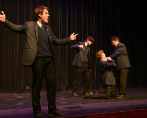 Zac Bell (front) performs a scene from Romeo and Juliet with fellow King's High School pupils ...