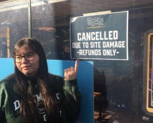 Disappointed ticket holder Shikeya Sue outside World Bar in Queenstown where Mardis Gras...
