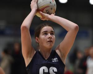 Otago Girls' High School goal shoot Abby Harris (16) lines up a shot during her team's Dunedin...