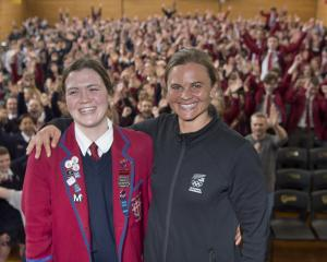 Kavanagh College swimmer Erika Fairweather (left) reacts after being announced by former Otago...
