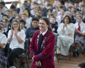 New Olympian Erika Fairweather is cheered on stage by her Kavanagh College classmates at the...
