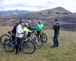 Instructor Chris Foggin teaches a group of riders on the Cycling Uncovered programme next to Lake...