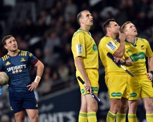 Watching the big screen at Forsyth Barr Stadium on Saturday night are Highlanders first five...