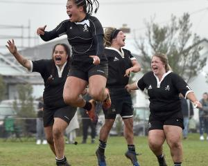Pirates players celebrate their win in the Women's Premier rugby final against University at...