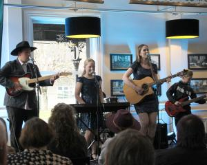 Rocking the stage are Nelson's Harmony Hunters. The group won the open group section in the...