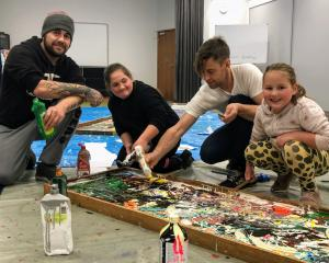 Quenton Nankivell (left) took his daughters, Wikitori (10) and Mihiana (7), to help local artist...
