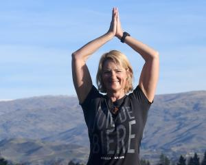 Shelley Charlton loves doing yoga on the beach but has to make do with Lake Dunstan in Cromwell....
