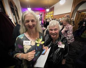 Association of University Women president Shirley Gillett (left) and Lorraine Isaacs catch up at...