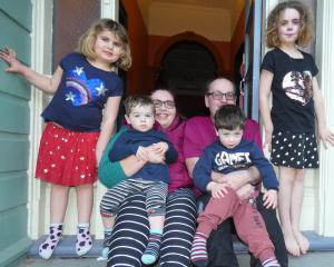 Sarah and Jason McCook, with their children (from left) Isabel (6), Cooper (2), Connor (4) and...