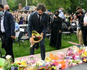 Canadian Prime Minister Justin Trudeau places flowers at a vigil outside the London Muslim Mosque...